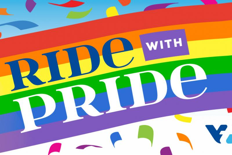 Ride Pride slogan in a rainbow