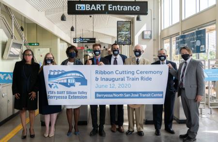 BART and VTA officials hold opening banner